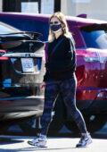 Sarah Michelle Gellar dons blue camo leggings and black sweatshirt while running errands in Brentwood, California