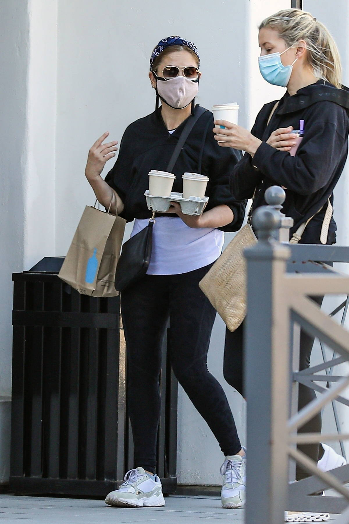 Sarah Michelle Gellar double masks while grabbing a coffee to go at Blue Bottle with a friend in Brentwood, California