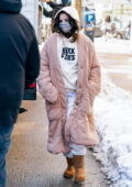 Selena Gomez bundles up in a full-length hooded jacket as she arrives on the set of 'Only Murders in the Building' in New York City