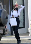 Shay Mitchell seen holding her drink as she leaves a salon in Los Angeles
