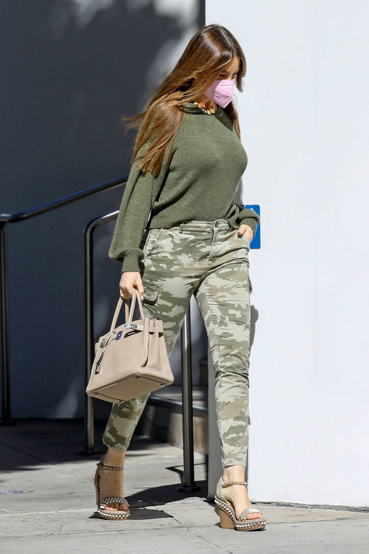 Sofia Vergara wears a green sweater and camo pants while out running errands in Beverly Hills, California