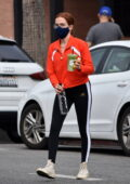 Zoey Deutch sports a red top and black leggings during a juice run at Alfred Coffee in Los Angeles