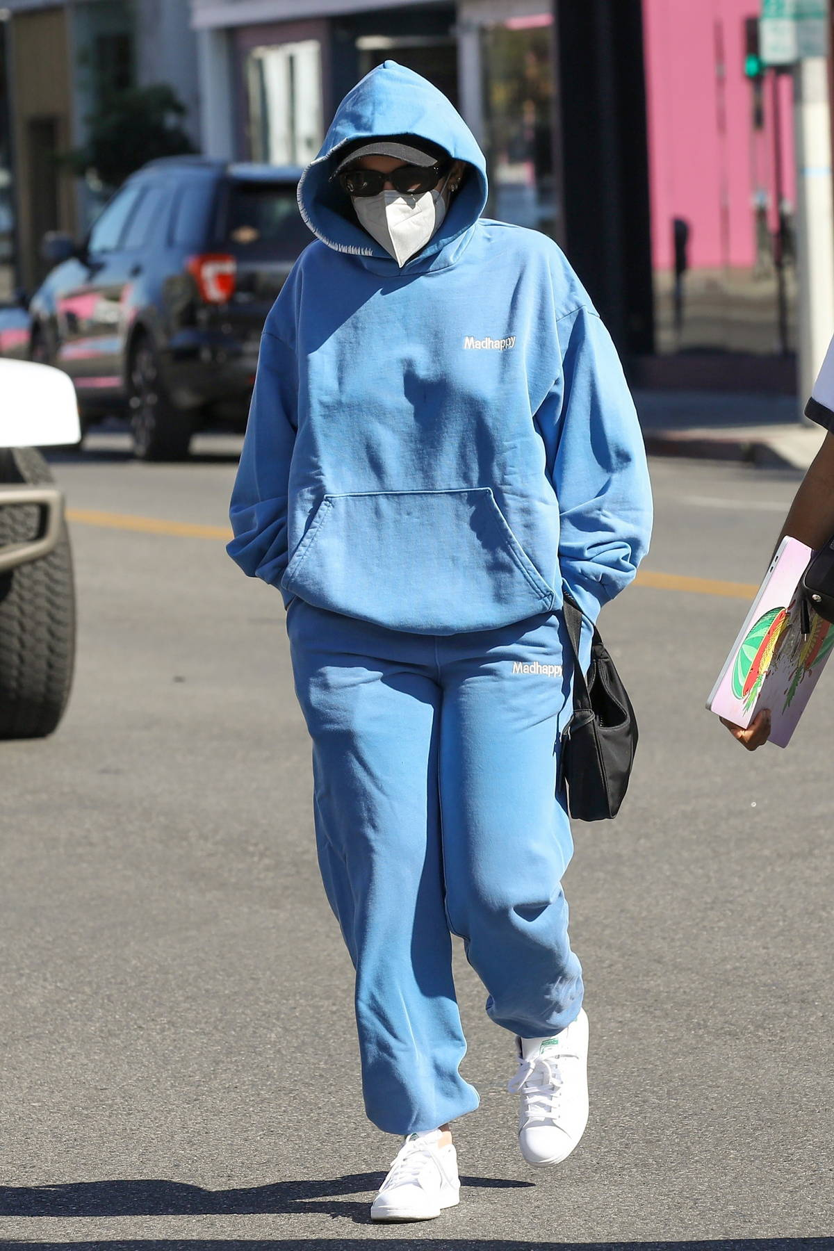 Addison Rae bundles up in a blue sweatsuit as she steps out in Los Angeles