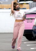 Addison Rae flashes her midriff in a 'Powerpuff Girls' cropped tee while visiting a hair salon in West Hollywood, California