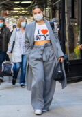 Addison Rae flashes her toned abs in a cropped 'I Love NY' tee paired with a grey suit as she leaves her Hotel in New York City