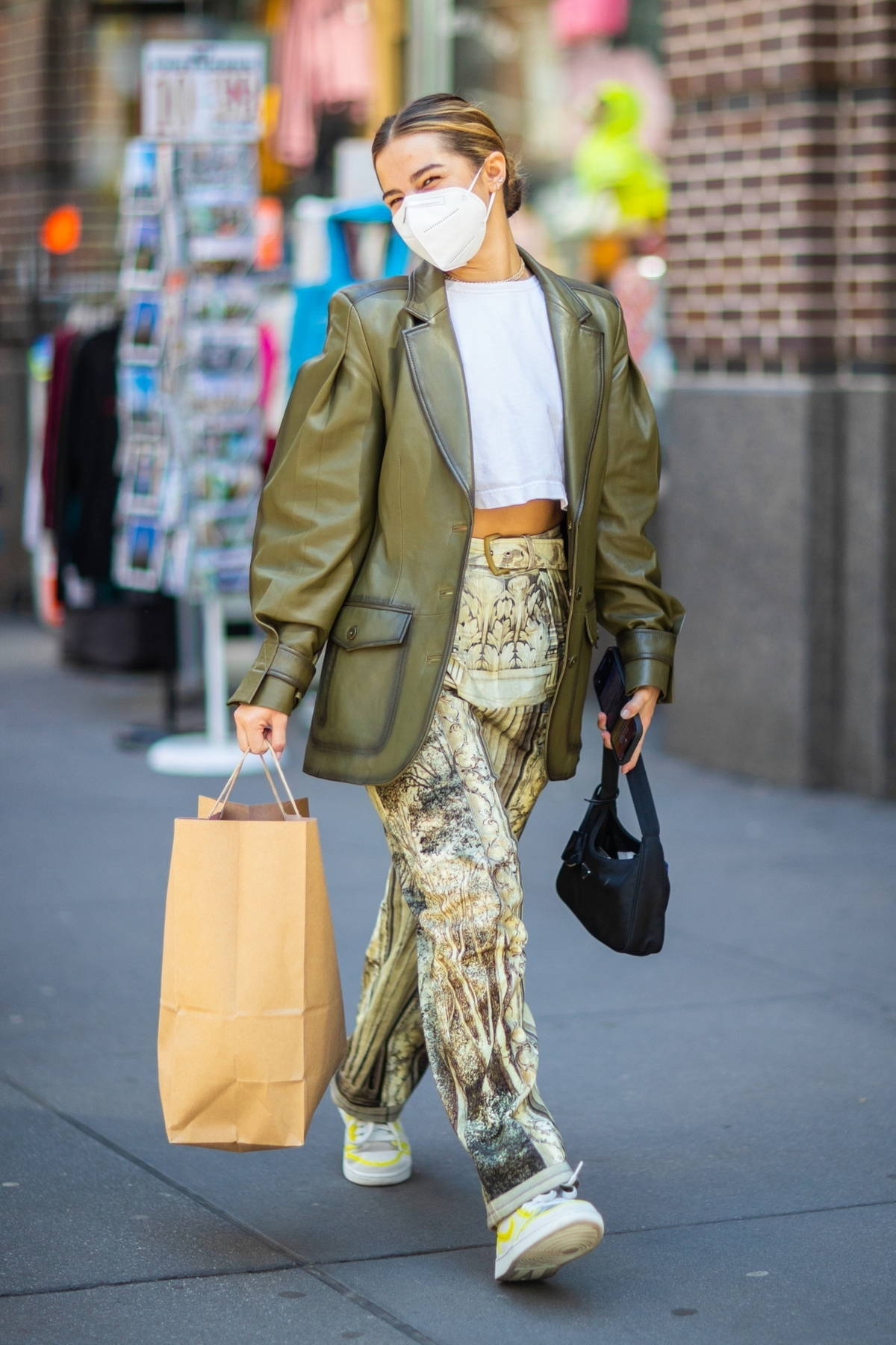 Addison Rae looks trendy in a green leather jacket and patterned pants while out for some shopping in New York City