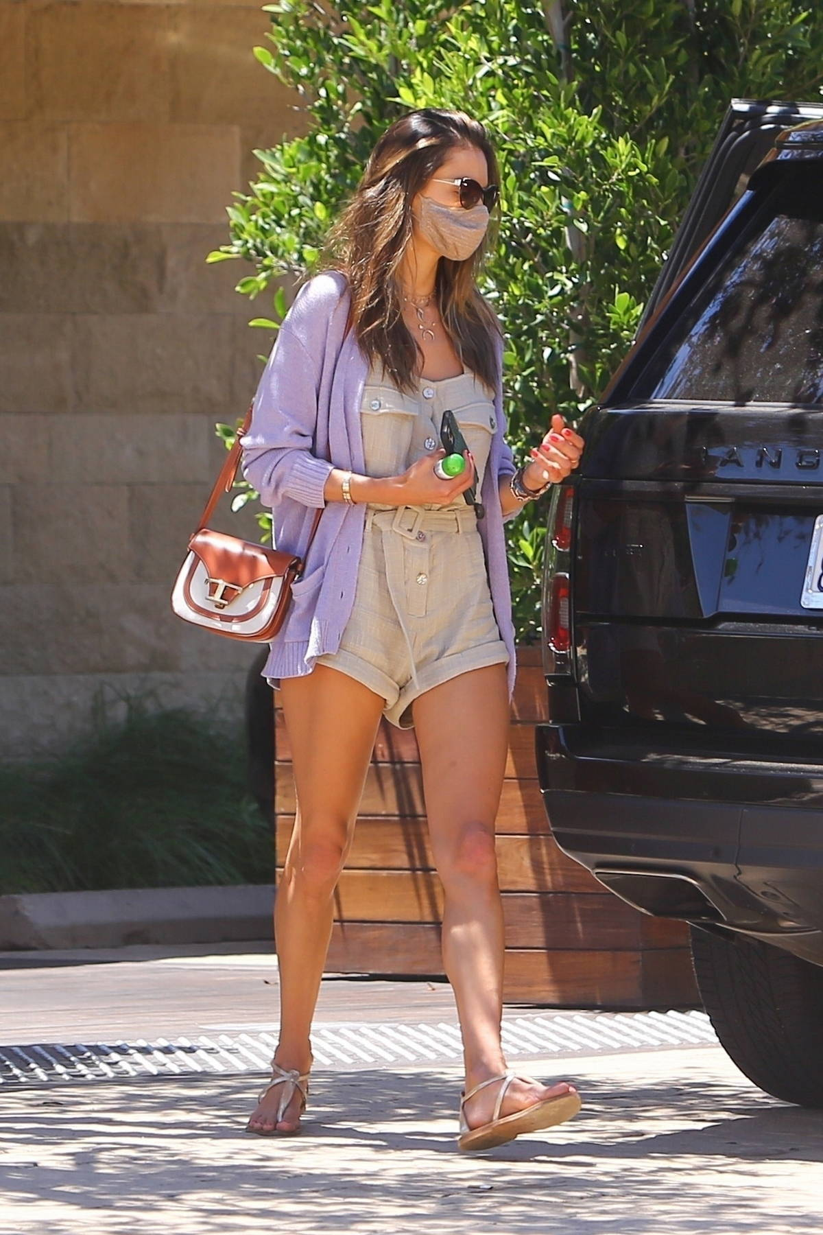 Alessandra Ambrosio displays her mile-long legs in a beige romper during a lunch outing at SoHo House in Malibu, California