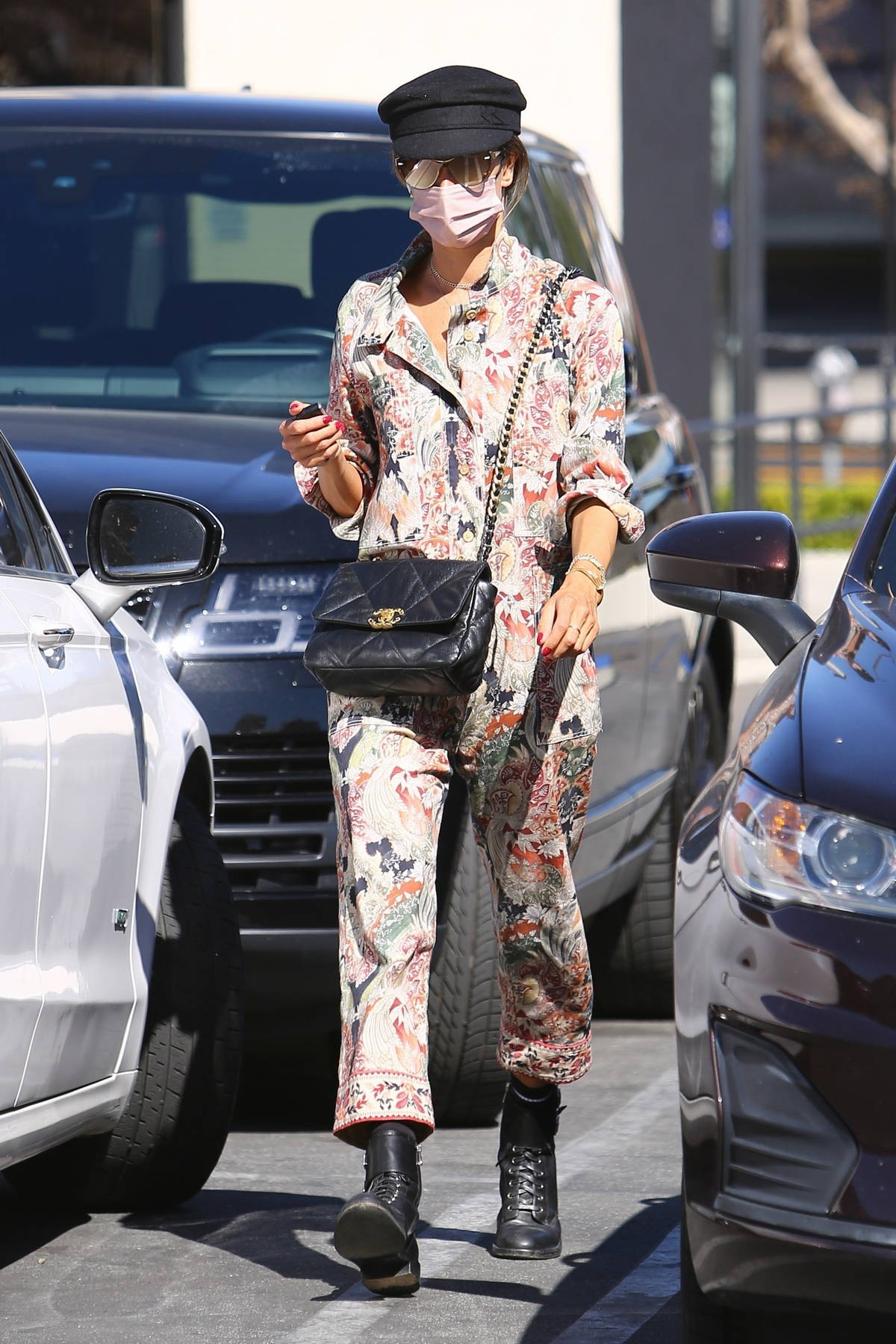 Alessandra Ambrosio dons a colorful patterned jumpsuit while visiting a skin care clinic in Los Angeles