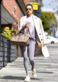 Alessandra Ambrosio looks amazing in purple leggings and top with a chic coat while attending a Pilates class in Los Angeles