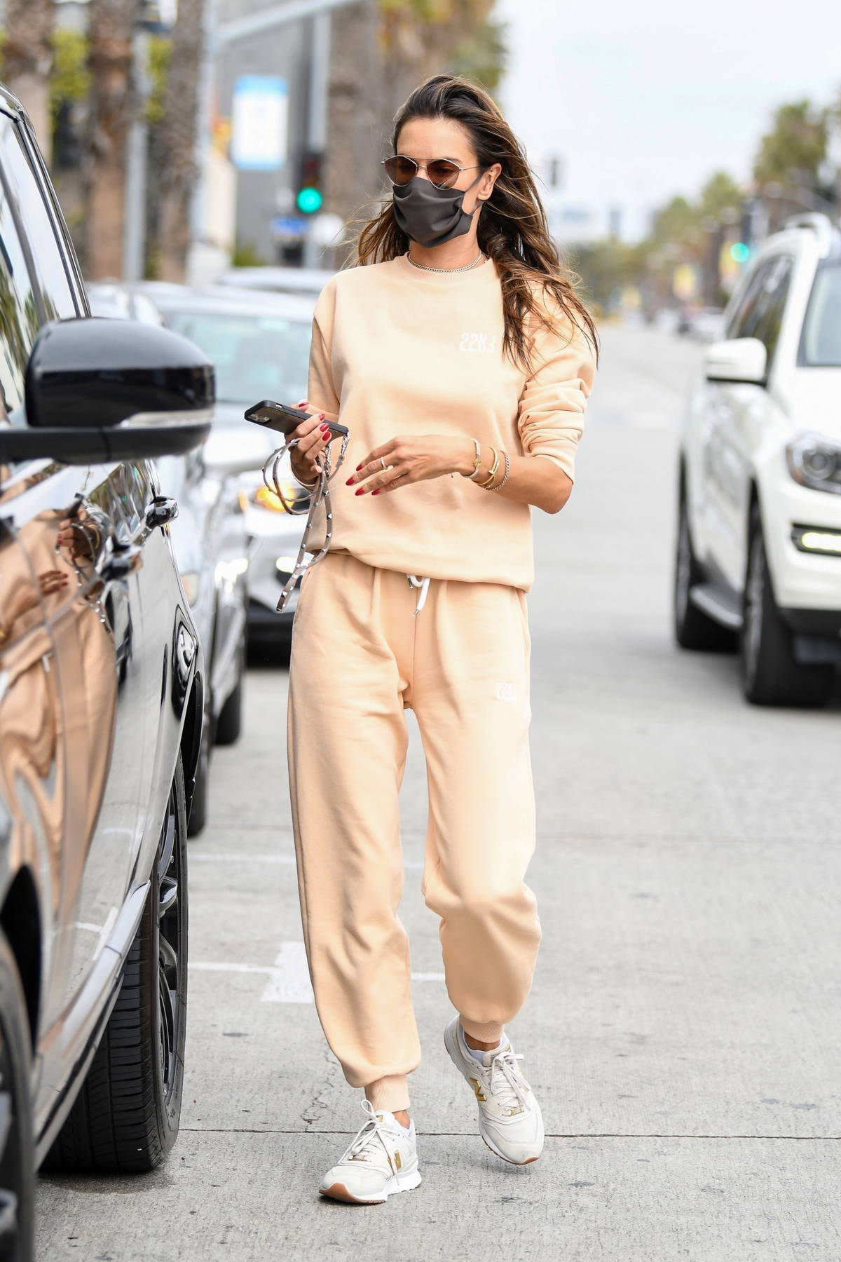Alessandra Ambrosio looks casual yet chic in a peach sweatsuit as she steps out for lunch in Brentwood, California