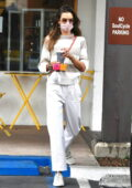 Alessandra Ambrosio looks casually chic in a striped sweater and white pants while stopping by Caffe Luxxe in Brentwood, California