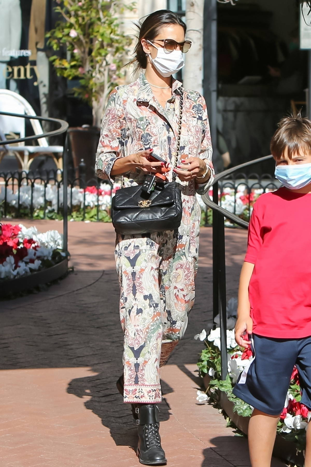 Alessandra Ambrosio looks stylish in a patterned jumpsuit as she takes her kids out for lunch in Pacific Palisades, California