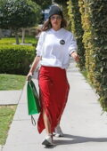 Alessandra Ambrosio looks stylish in side-slit red pants paired with a white hoodie during a shopping trip in Los Angeles