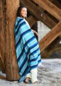 Alessandra Ambrosio poses during a beach photoshoot in Malibu, California