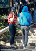 Alison Brie sports a red tee and black leggings while out for coffee with husband Dave Franco in Los Feliz, California