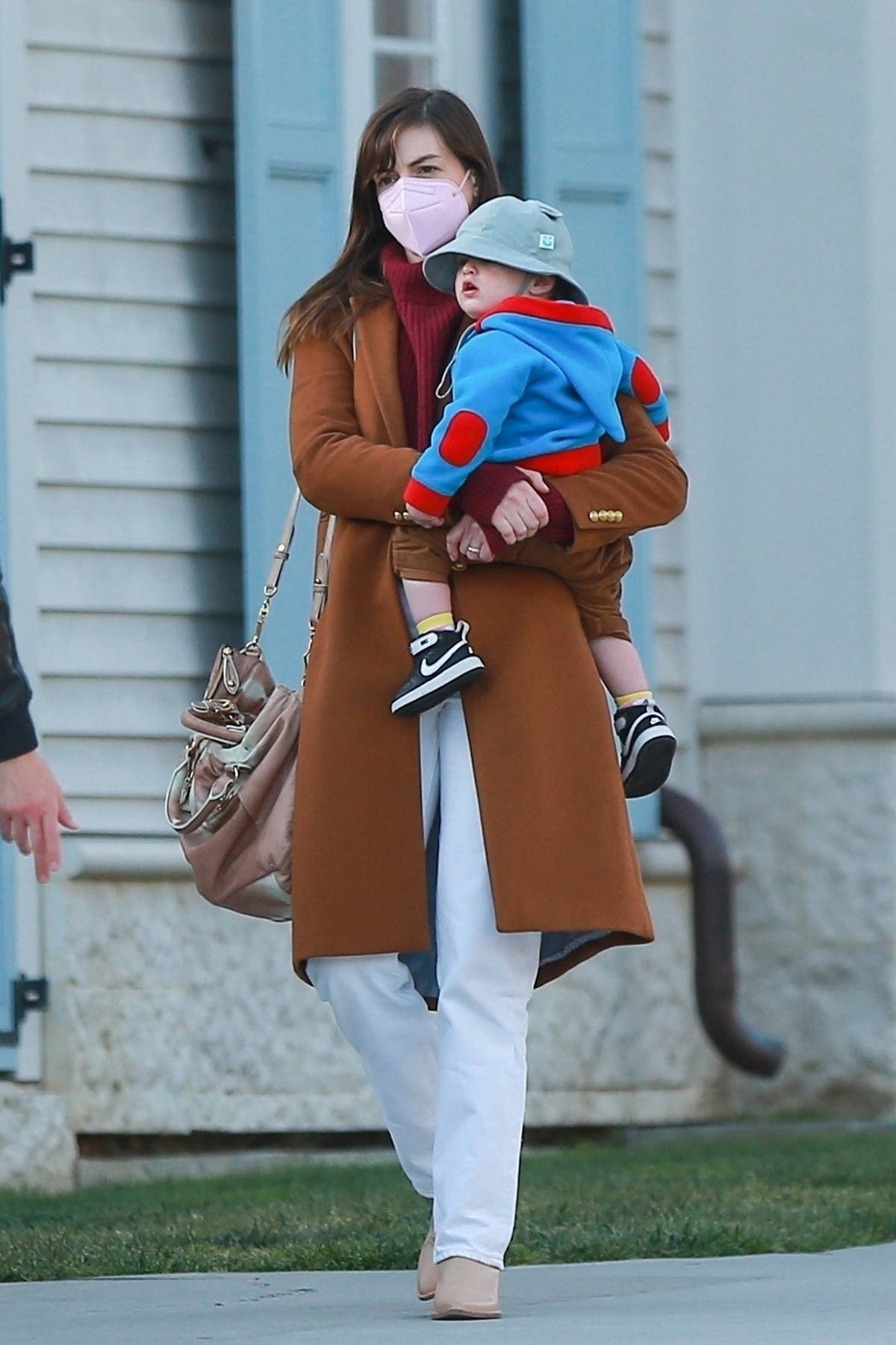 Anne Hathaway carries her son on her hip while out for a dinner with her family in Santa Monica, California