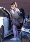 Ariana Grande seen wearing a puffer jacket and leggings as she arrives at a friend's house in Los Angeles