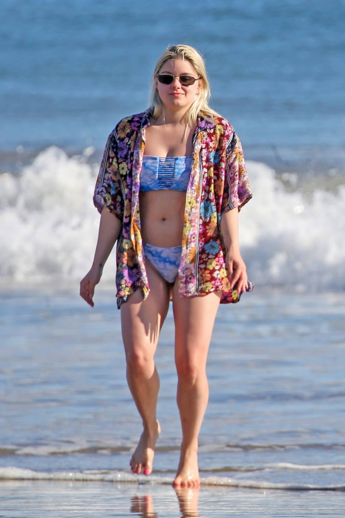 Ariel Winter stuns in a blue bikini while enjoying a beach day with boyfriend Luke Benward in Santa Barbara, California