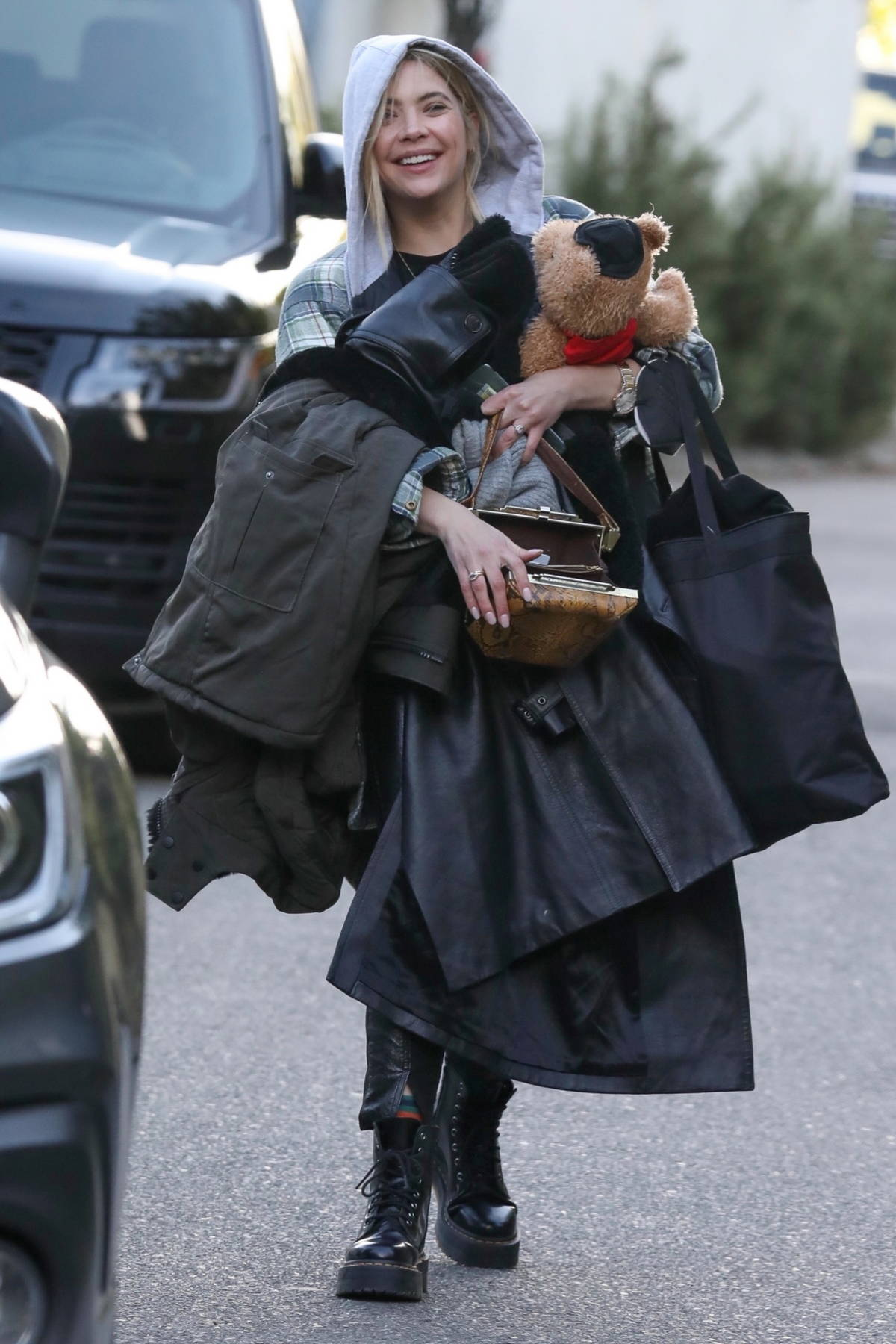 Ashley Benson is all smiles as she brings along a teddy bear while visiting a friend's house in Encino, California