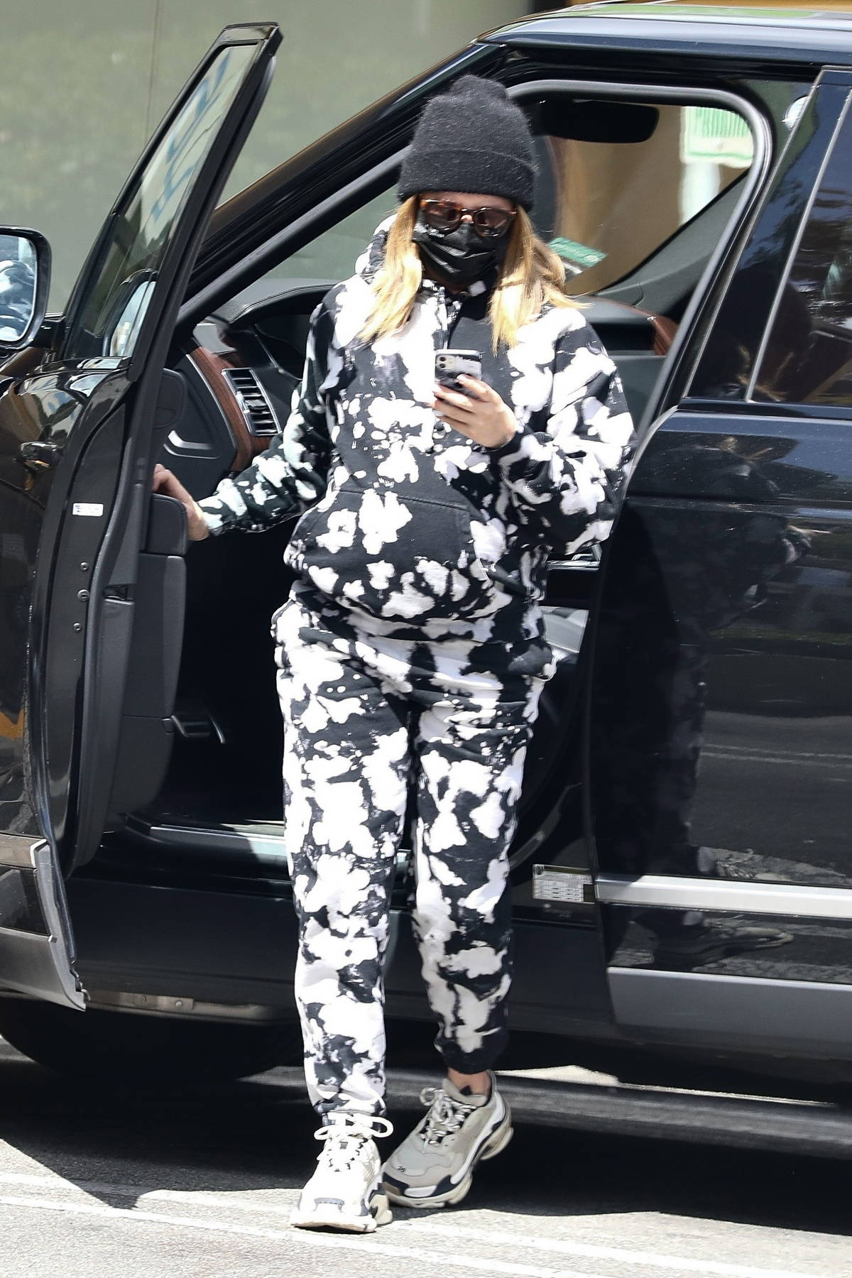 Ashley Tisdale dons comfy tie-dye sweats as she stops for a smoothie at the Earthbar in Beverly Hills, California