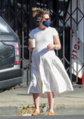 Ashley Tisdale seen wearing a white dress as she steps out for afternoon coffee run in Los Feliz, California