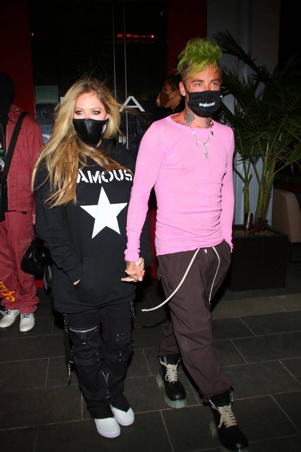 Avril Lavigne and Mod Sun hold hands as they leave after a dinner date at BOA steakhouse in West Hollywood, California