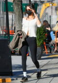Bella Hadid keeps it chic with a white top and black leggings as she steps out for lunch at Bar Pitti in New York City