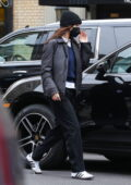 Bella Hadid keeps it low-key in a black beanie and a blue sweater with Adidas sneakers as she steps out in New York City