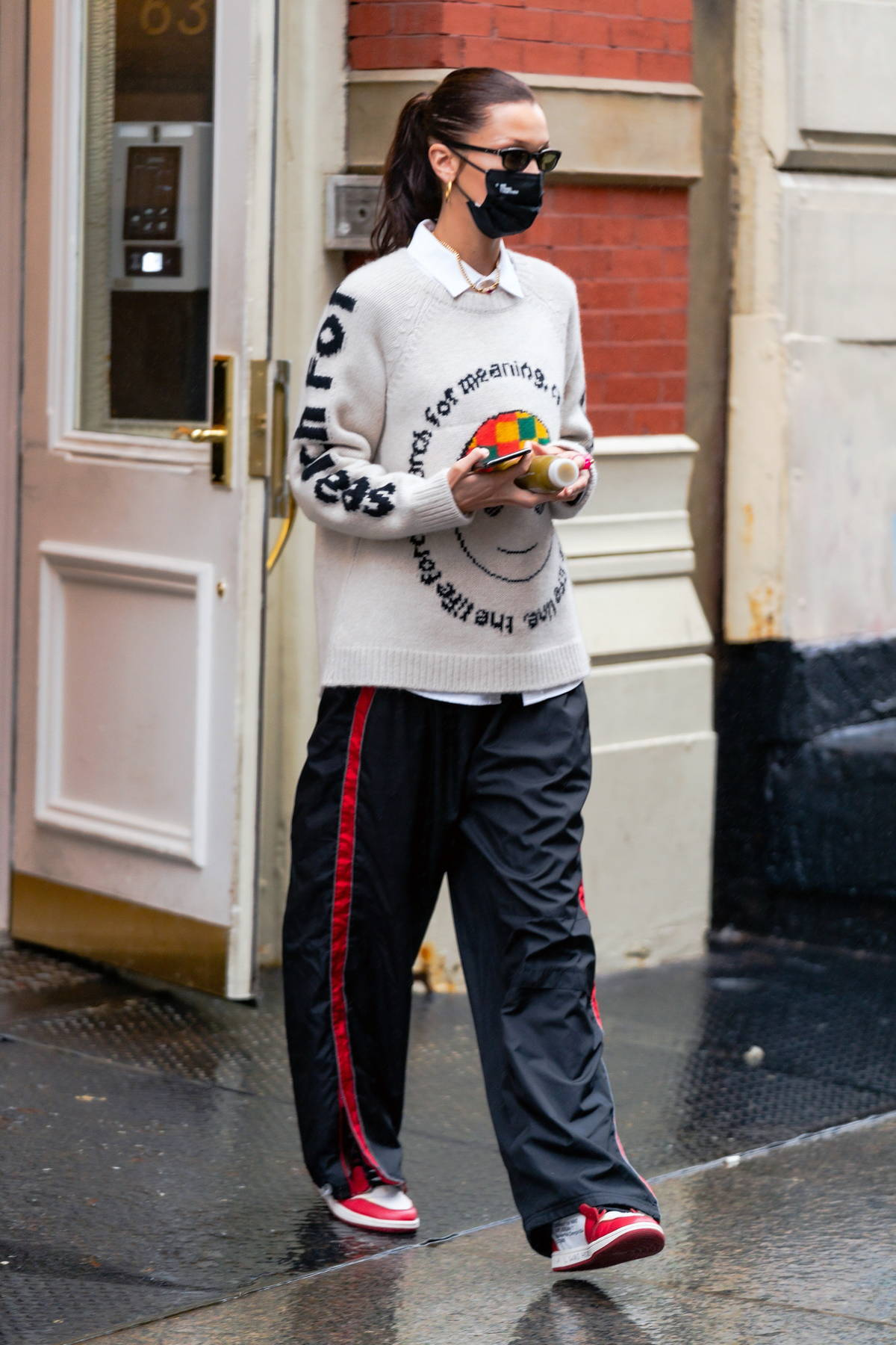 Bella Hadid looks cool in a sweater with a message as she leaves her apartment in New York City