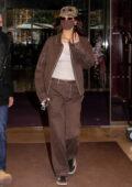 Bella Hadid looks trendy in brown ensemble as she leaves her hotel in Paris, France