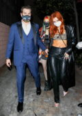 Bella Thorne flaunts her midriff in a crop top beneath leather trench coat while attending a birthday party in Hollywood, California