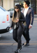 Blac Chyna flaunts her curves in a skintight snakeskin jumpsuit as she leaves a nail salon in Los Angeles