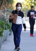 Camila Cabello wears a three-toned sweater and tight jeans for a business meeting in Los Angeles