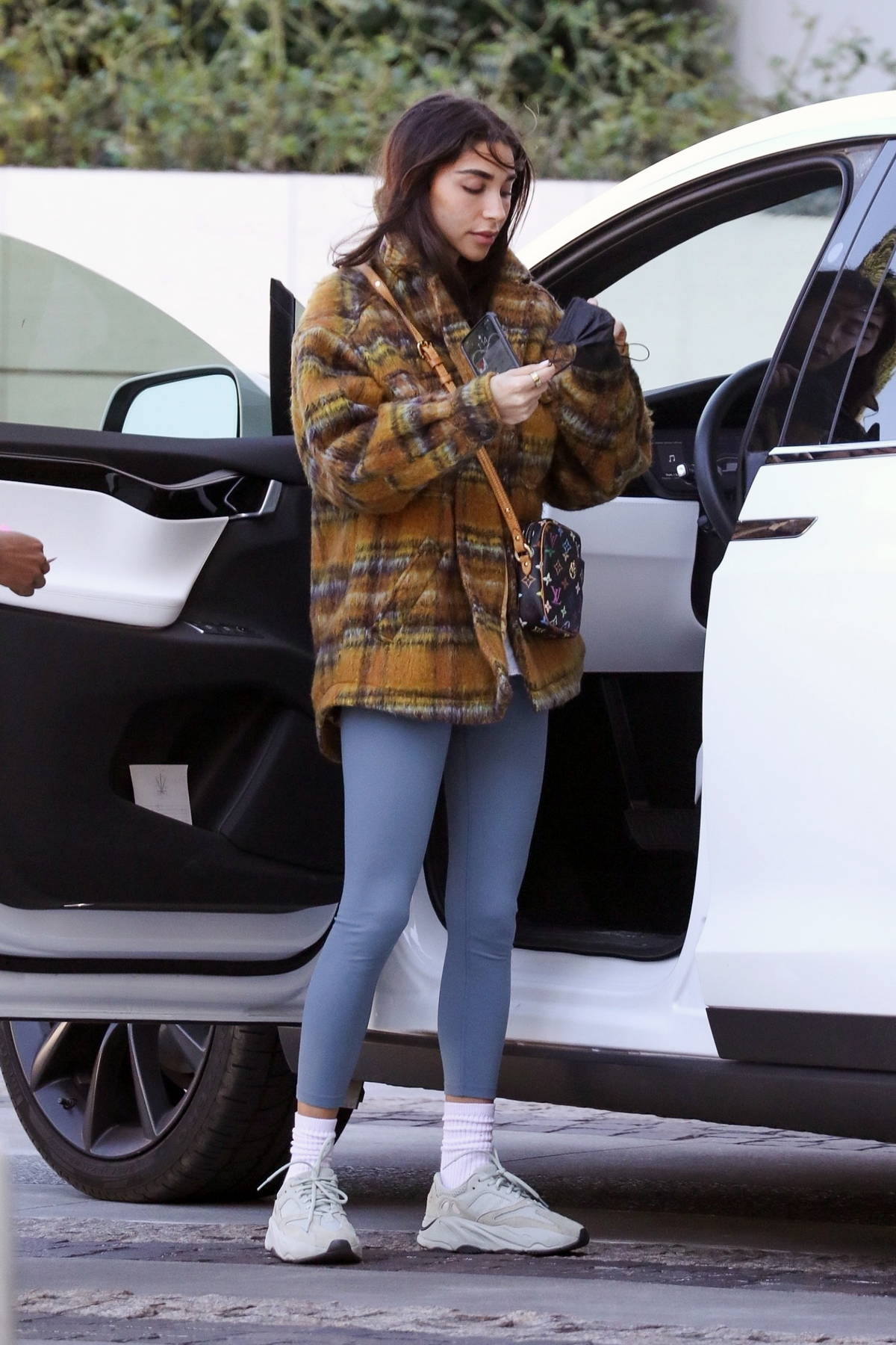 Chantel Jeffries wears a flannel shirt and leggings as she meets up with friends at a local hotel in Los Angeles