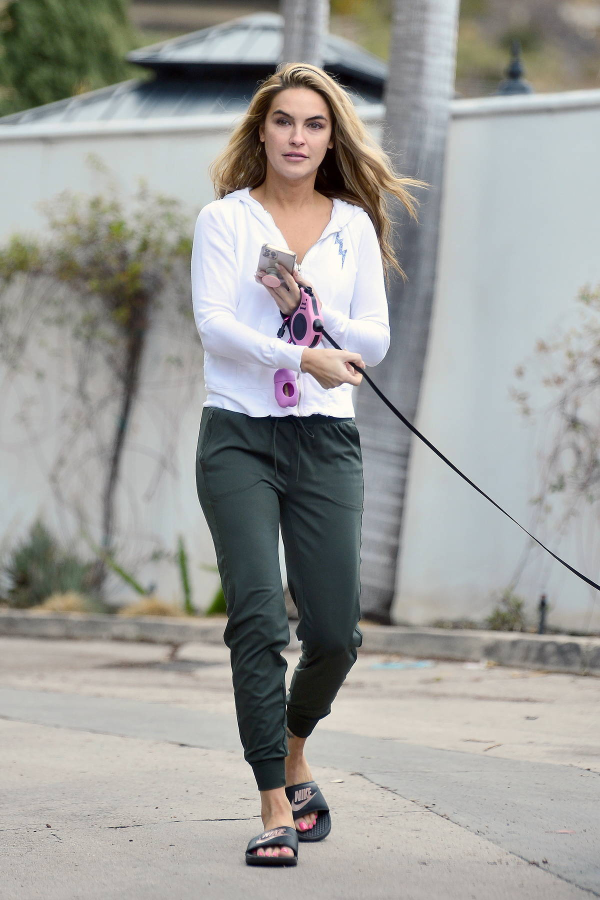Chrishell Stause seen for the first time after splitting with Keo Motsepe as she steps out to walk her dog in Los Angeles