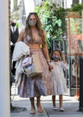 Chrissy Teigen and John Legend have a family lunch outing at Crustacean in Beverly Hills, California