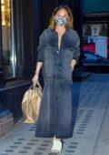 Chrissy Teigen dons a denim dress while out running errands with John Legend in New York City