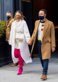 Chrissy Teigen looks stylish in thigh-high pink boots while out with John Legend in New York City
