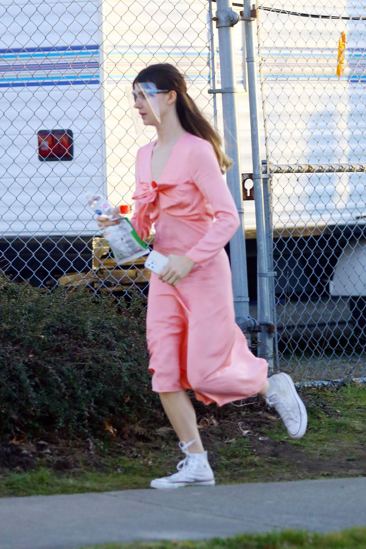 Daisy Edgar-Jones spotted in sweatsuit before changing into a pink dress while on the set of 'Fresh' in Vancouver, Canada
