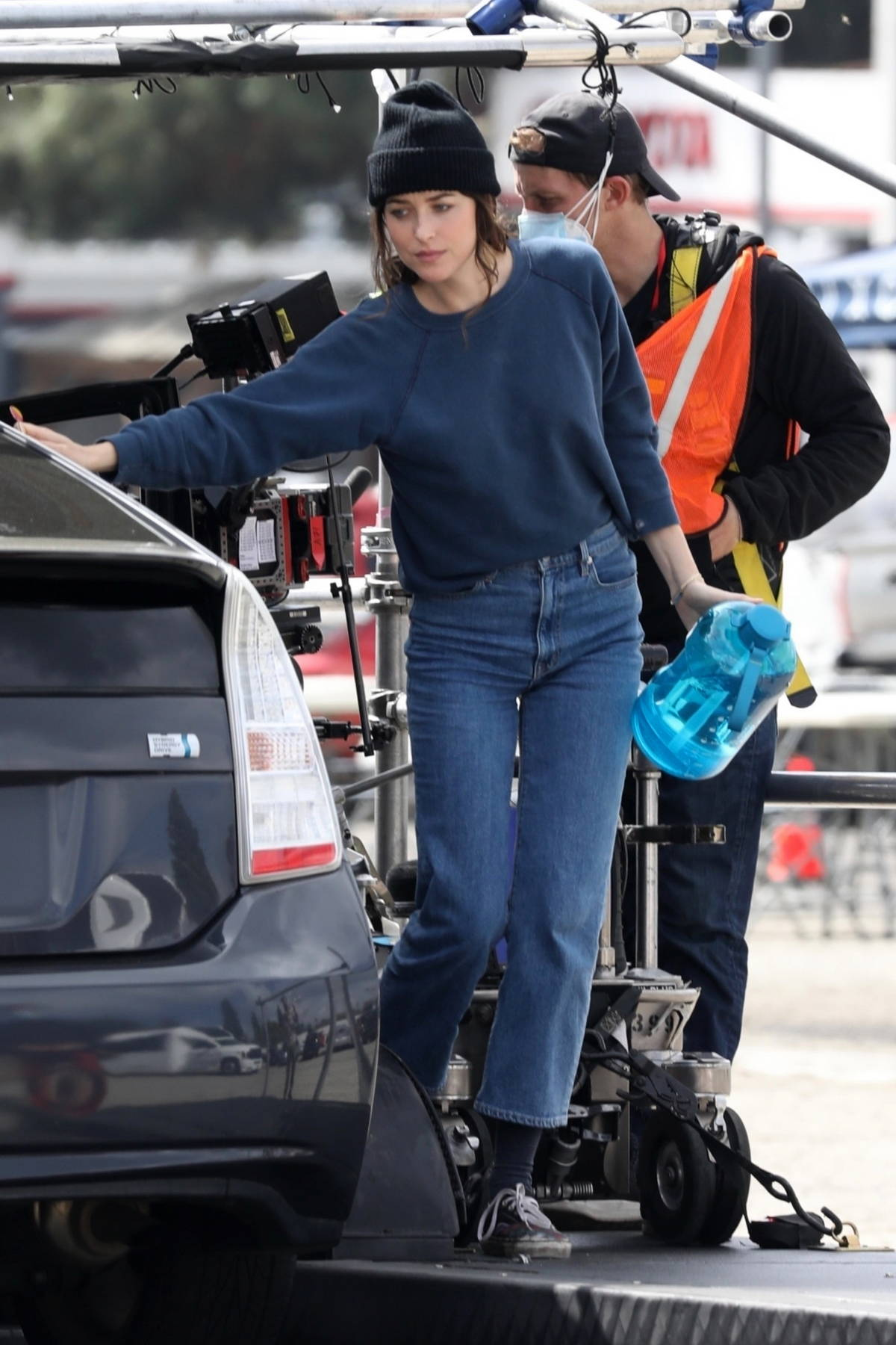 Dakota Johnson enjoys a lollypop on the set of 'Am I OK' while filming a car scene in Los Angeles