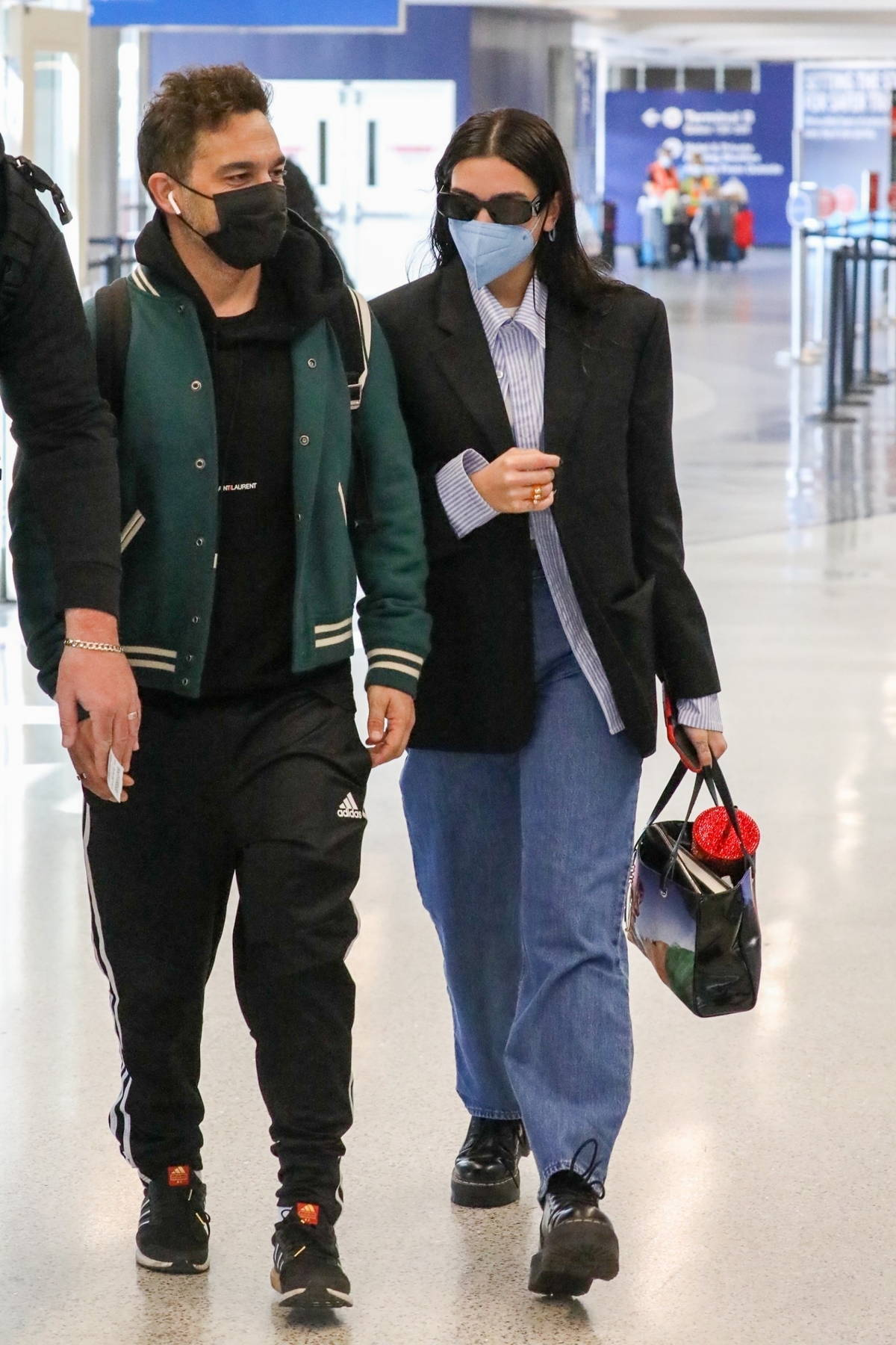 Dua Lipa looks sharp in a black blazer and jeans as she arrives for a flight out of LAX airport in Los Angeles