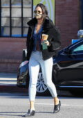 Eiza Gonzalez flashes her taut midriff in an unbuttoned cardigan while making a coffee run in West Hollywood, California