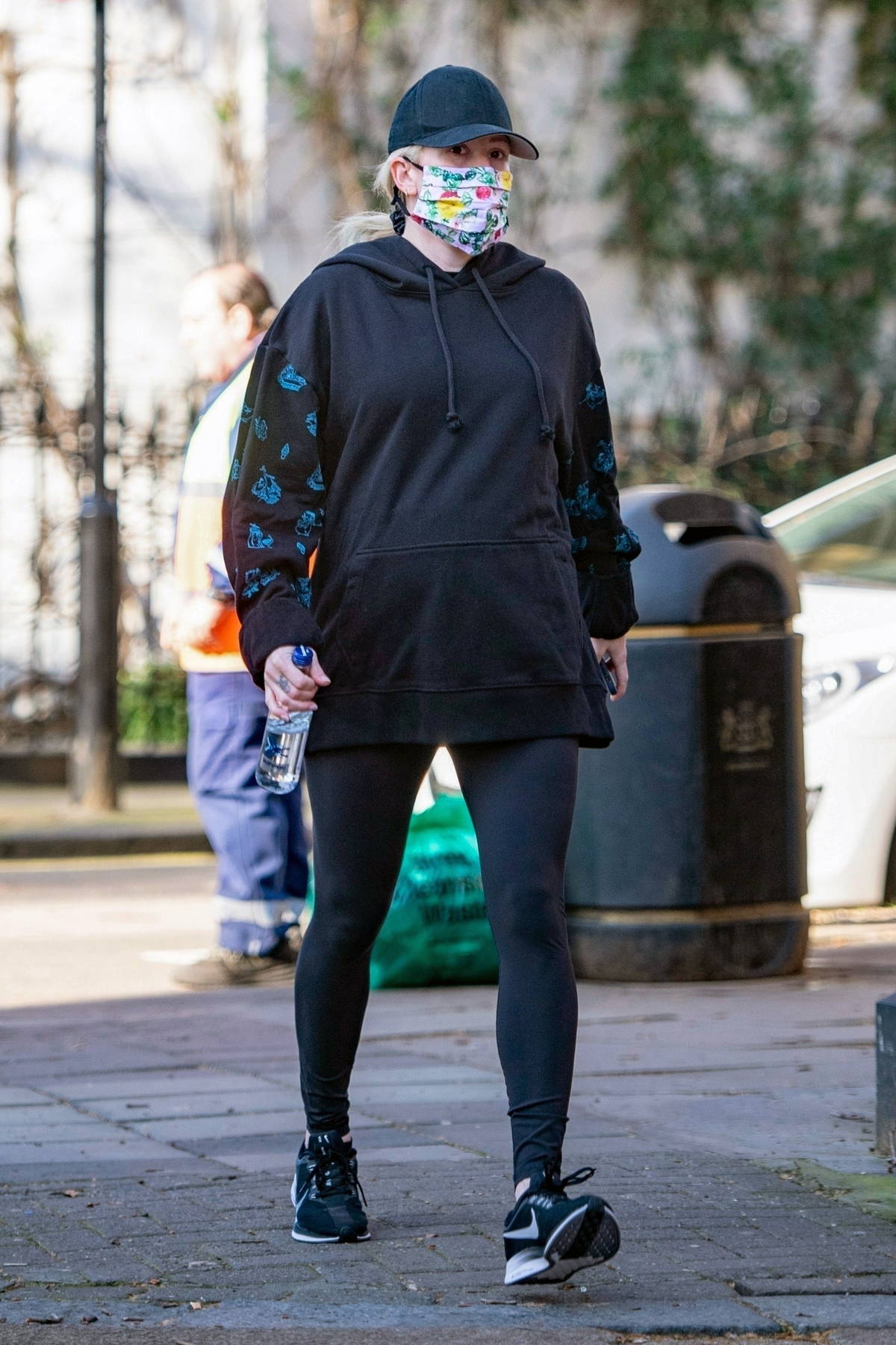 Ellie Goulding shows her baby bump as she steps out for the first time since revealing her 8 months pregnancy, London, UK