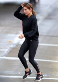 Elsa Pataky steps out in the rain wearing a black sweatshirt and leggings in Sydney, Australia