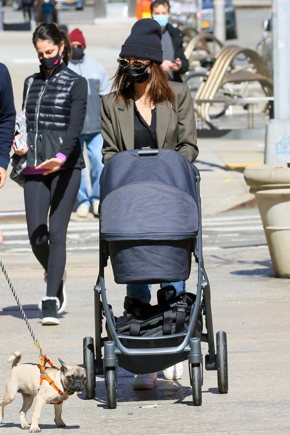 Emily Ratajkowski enjoys a stroll with her newborn baby after having lunch at the Oden in New York City