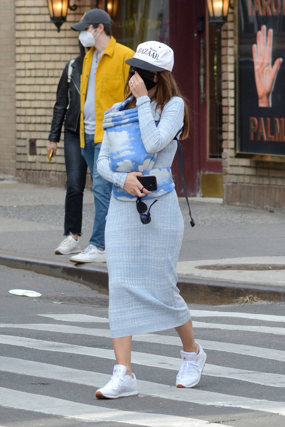 Emily Ratajkowski straps her baby on her chest while for lunch with husband Sebastian Bear-McClard in new York City