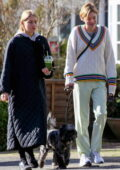 Emma Corrin grabs a Pizza with a friend on a dog walk while enjoying the sunshine in North London, UK