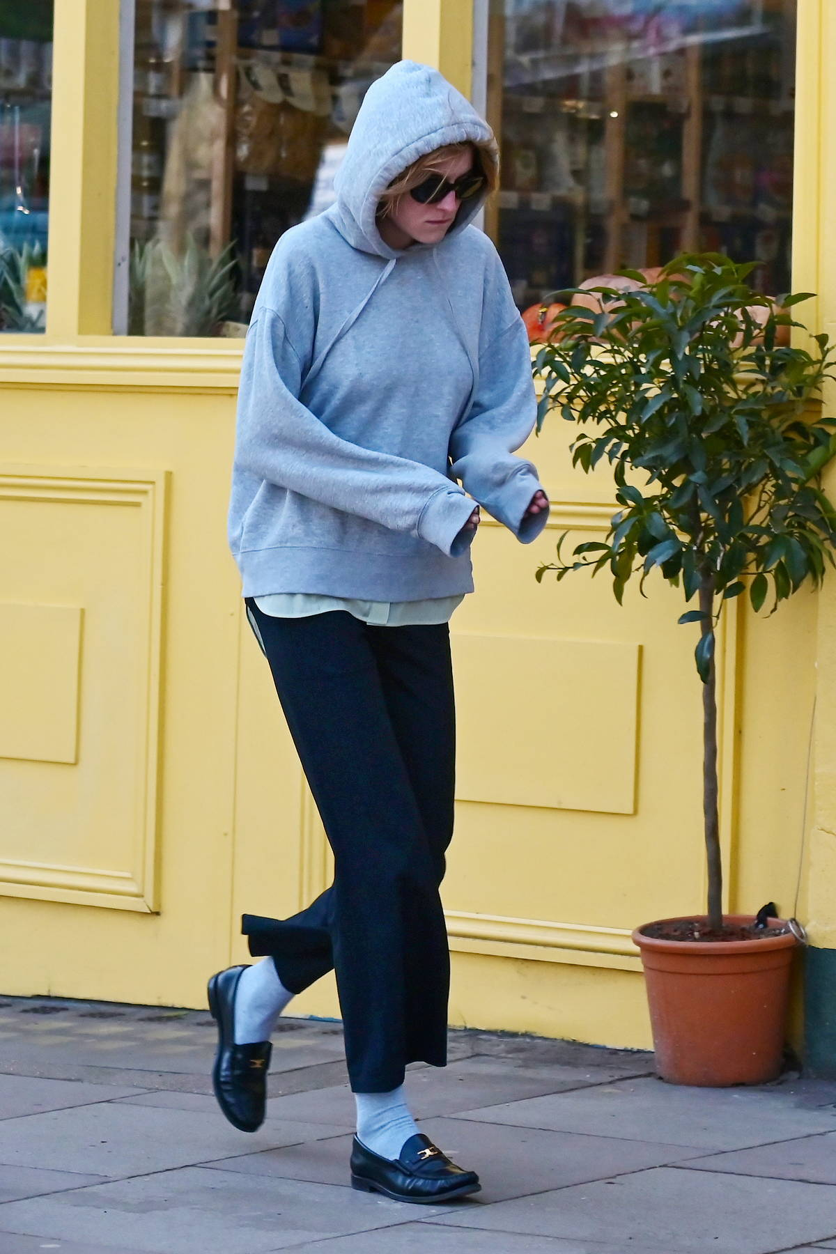 Emma Corrin keeps warm in a hoodie while stepping out to grab a cup of coffee in North London, UK