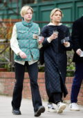 Emma corrin sports 'The North Face x Gucci' designer biker jacket while out for stroll with friends in North London, UK