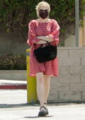 Emma Roberts looks cute in a red and white checkered dress while out shopping at Squaresville vintage in Los Feliz, California